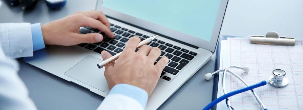 Header-Man-on-Laptop-Typing